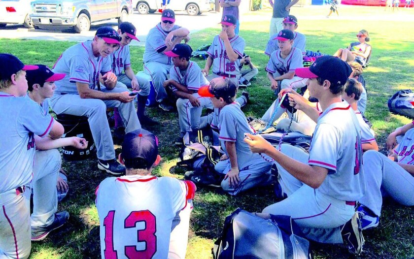 Manager Tim Scott talks with the La Jolla Pony team after their 14th and final all-star game from the Section, Region and Super Region tournaments. La Jolla Pony had the youngest roster in Southern California and finished with an 8-6 record, including four games at Super Region.