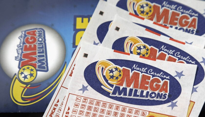 FILE - In this July 1, 2016, file photo, Mega Millions lottery tickets rest on a counter at a Pilot travel center near Burlington, N.C. The Mega Millions jackpot received a boost to over $500 million for the Friday, July 8, drawing after no one picked the right numbers Tuesday night. (AP Photo/Gerr