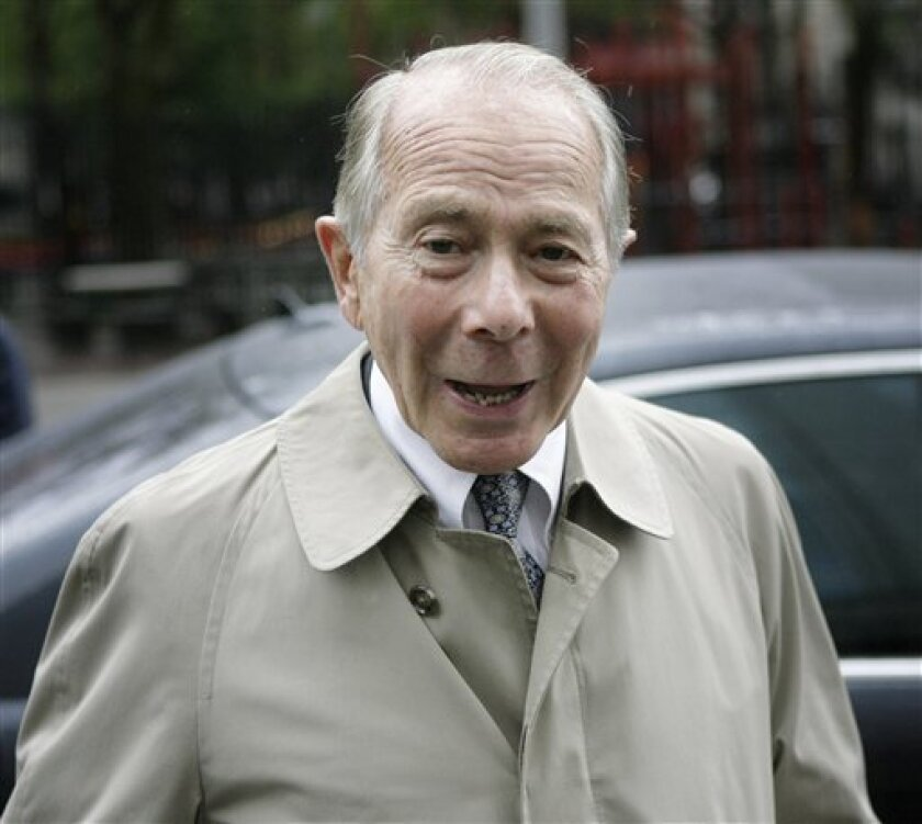 FILE - In this June 18, 2009 file photo, former American International Group (AIG) Inc. CEO Maurice 'Hank' Greenberg enters Manhattan federal court in New York. In an advisory decision, a federal jury in Manhattan on Tuesday, July 7, 2009 found that a private investment firm controlled by Greenberg did not have to reimburse AIG for $4.3 billion in shares taken from a company retirement bonus fund in 2005, shortly after Greenberg was ousted as the insurer's CEO. (AP Photo/Seth Wenig, file)