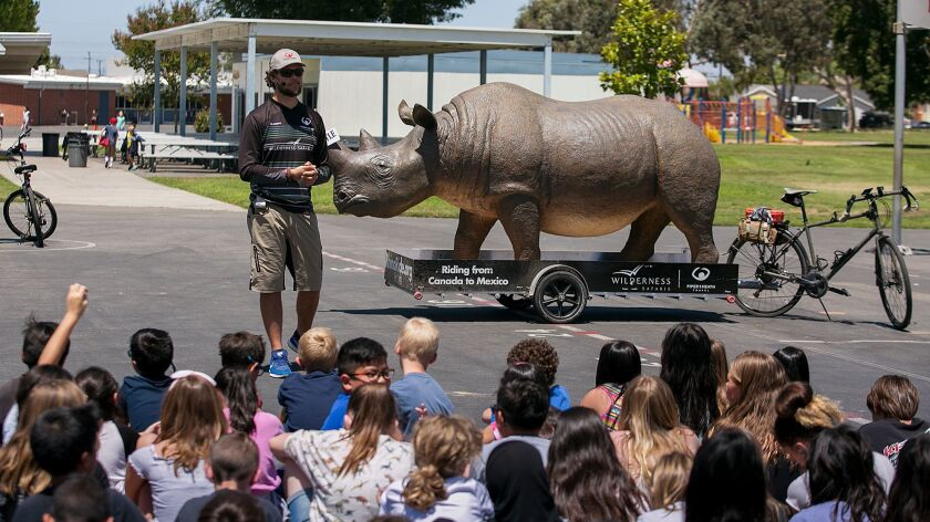 Matt Meyer, a South African safari guide, speaks to students at Circle View Elementary School in Huntington Beach about the dangers rhinoceroses face.