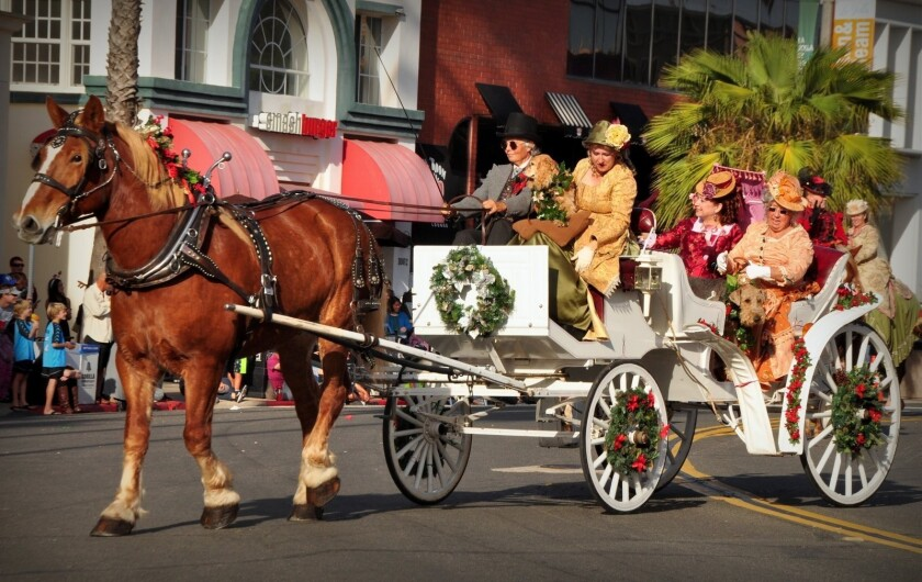A scene from a previous La Jolla Christmas Parade. The 2019 event starts 1:30 p.m. Sunday, Dec. 8 with the parade route on Girard Avenue and Prospect Street. A Holiday Festival outside the Athenaeum Music & Arts Library, 1008 Wall St., runs 11 a.m. to 1 p.m. prior to the start of the parade.