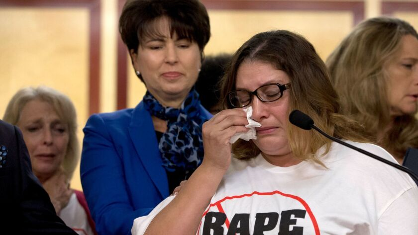 Norma Hernandez wipes her eyes as she talks about being raped when she was 13. The stories of women who say they were sexually assaulted by comedian Bill Cosby prompted California lawmakers to pass a bill last year to eliminate the state's 10-year limit on filing rape.