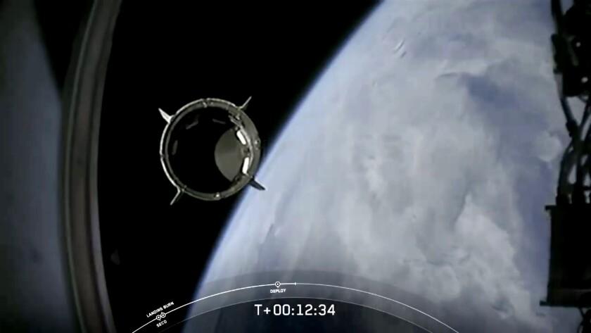 The Dragon spacecraft with astronauts Bob Behnken and Doug Hurley