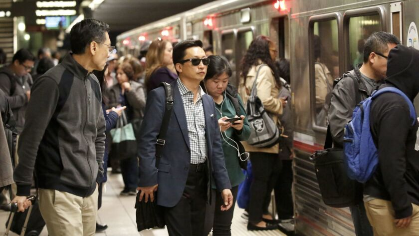 Commuters pass through Union Station in downtown Los Angeles. The president's executive order has been disorienting to many in and around Los Angeles — in part, they say, because their lives intersect with so many people of so many cultures.