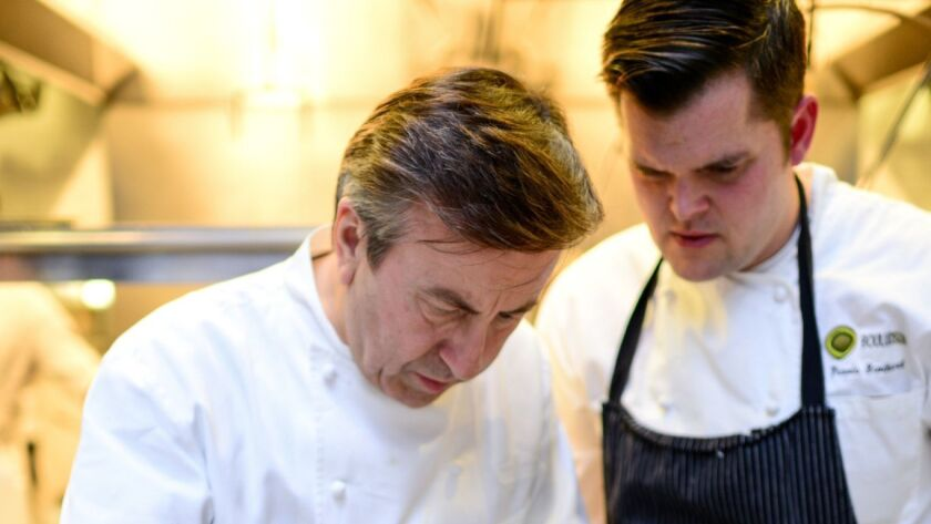 Chefs Daniel Boulud (left) and Travis Swikard.