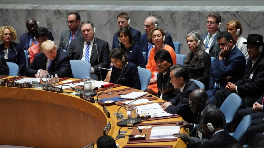 President Trump listens to Chinese Foreign Minister Wang Yi, right, during a United Nations Security Council meeting Wednesday on the second day of the U.N. General Assembly in New York.