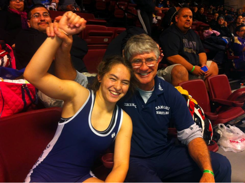 Santa Monica High School science teacher and wrestling coach Mark Black, right, was put on leave after a physical altercation with a student in his classroom. Two students have been arrested. Here, he is shown at a CIF state tournament in Visalia last month with one of his standout athletes, Maddy Tung, a national champion and Olympic wrestling hopeful.