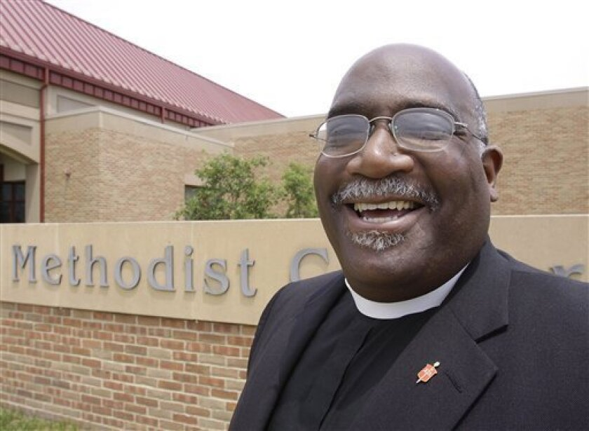 In this June 8, 2009 photo, Bishop Gregory Palmer poses for a photo in Springfield, Ill. Fifty United Methodist bishops in the United States will roll back their salaries by 4 percent next year in what Bishop Palmer, president of the Council of Bishops, says is a gesture of solidarity with others hurt by the global economic downturn. (AP Photo/Seth Perlman)