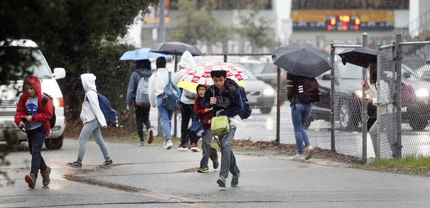 Photo Gallery: Rain pours at the end of the school day in La Canada