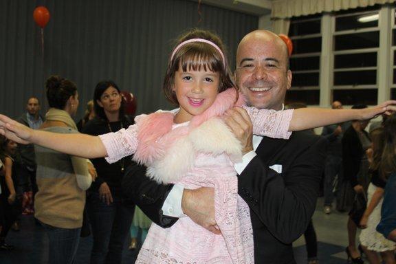 Tom Nishioka gives his daughter, Sophia, a lift at La Jolla Elementary School's annual family dance on Nov. 20, 2014.