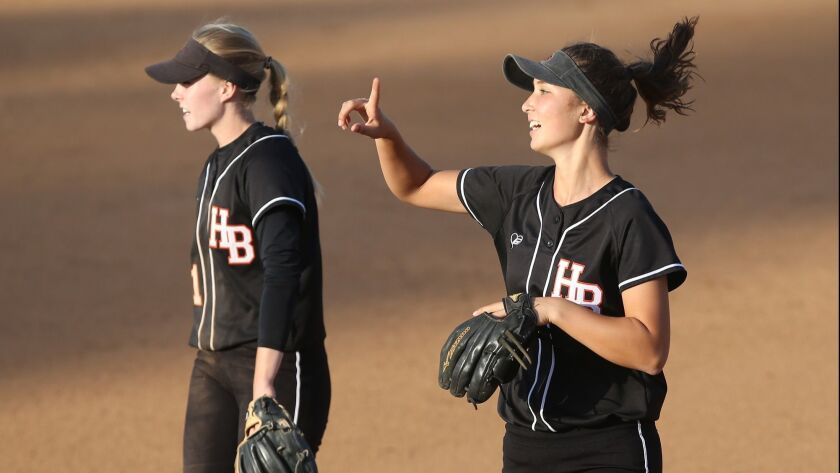 Huntington Beach all-stars Allee Bunker and Kelli Kufta, from left, take the field during the OC Coa