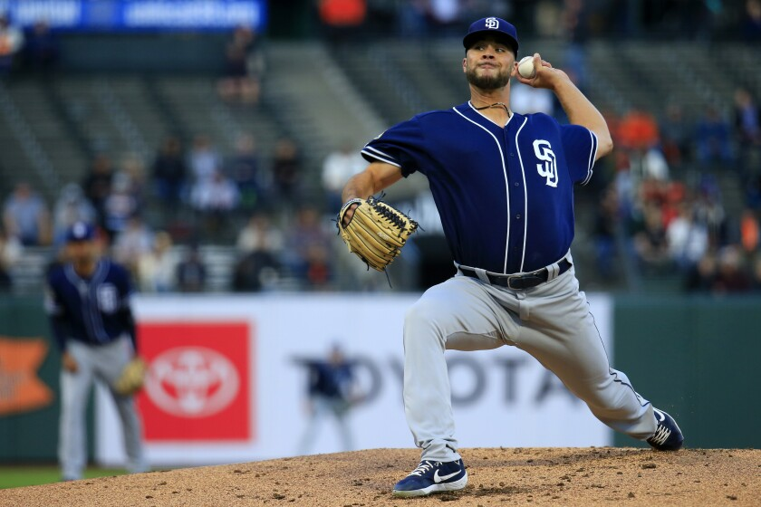 Padres starter Joey Lucchesi pitches during the first inning against the Giants at Oracle Park on Tuesday.