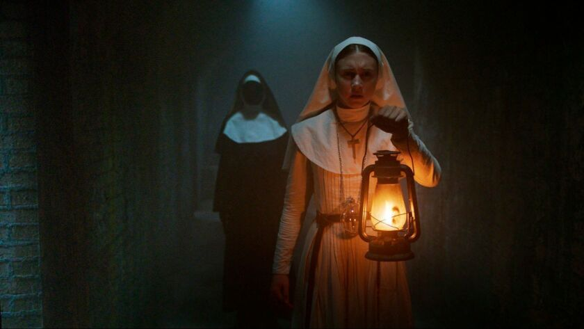 "Taissa Farmiga in a scene from ""The Nun."""