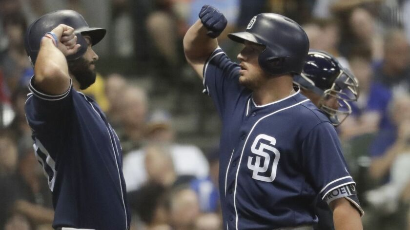 Hunter Renfroe, right, celebrates his two-run home run with Eric Hosmer during the sixth inning Wednesday against the Milwaukee Brewers.