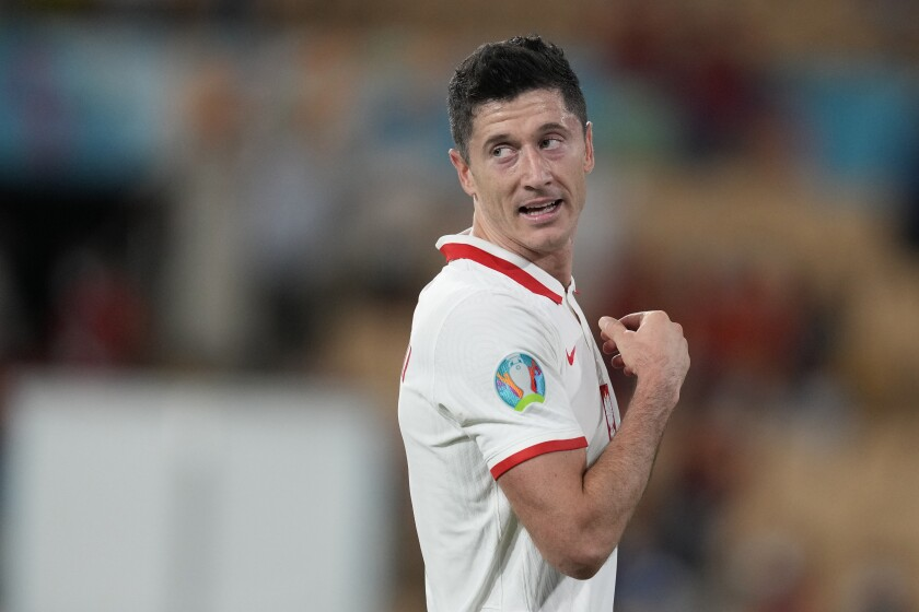 Poland's Robert Lewandowski celebrates after the Euro 2020 soccer championship group E match between Spain and Poland at La Cartuja stadium in Seville, Spain, Saturday, June 19, 2021. (AP Photo/Thanassis Stavrakis, Pool)