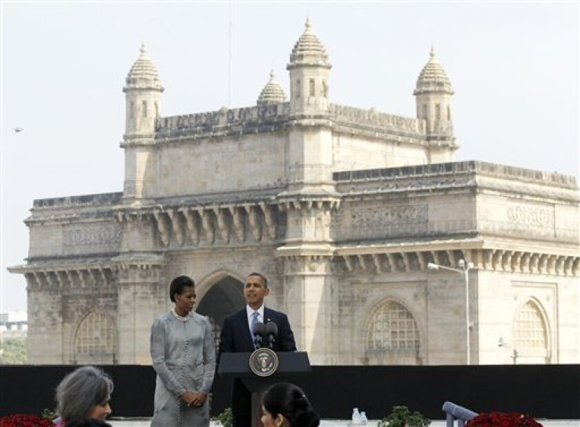 U.S. President Barack Obama and first lady Michelle Obama make a statement after their visit the memorial for the Nov. 26, 2008 terror attack victims at the Taj Mahal Palace and Tower Hotel in Mumbai, India, Saturday, Nov. 6, 2010. (AP Photo/Charles Dharapak)