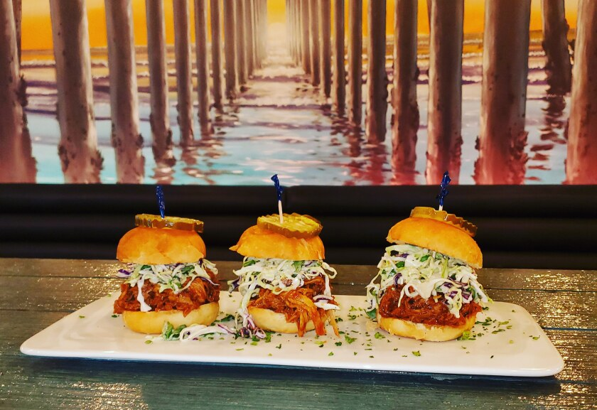 BBQ Pulled-Pork Sliders with slaw and pickles, under the Crystal Pier mural.