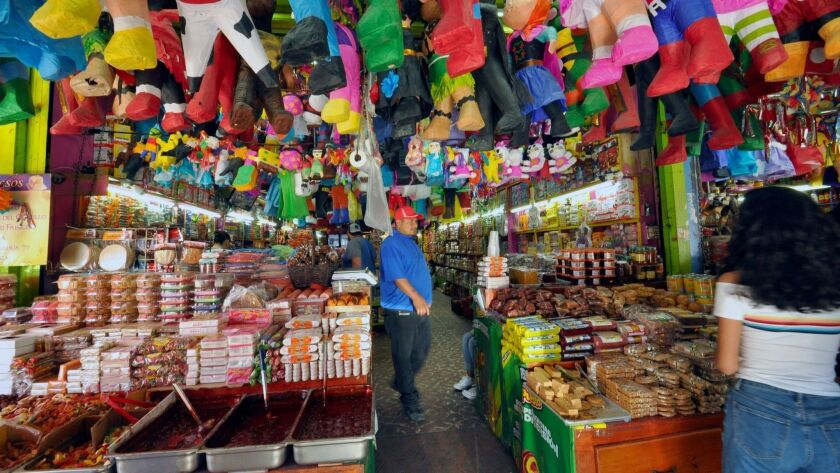 Tijuana's grand central market, Mercado Hidalgo, overflows with fresh produce, sweets and Mexican
