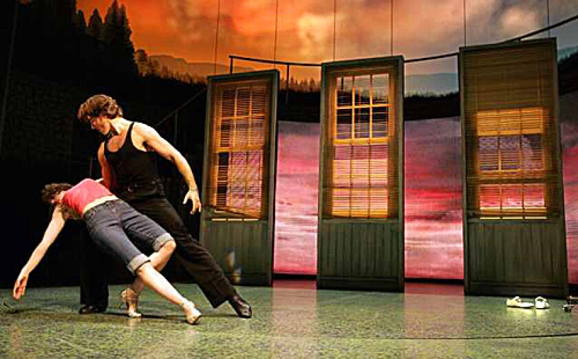 """BABY & JOHNNY: Georgina Rich and Josef Brown at a 2006 London rehearsal of """"Dirty Dancing — The Classic Story on Stage."""" The show opens today at the Pantages Theatre."""