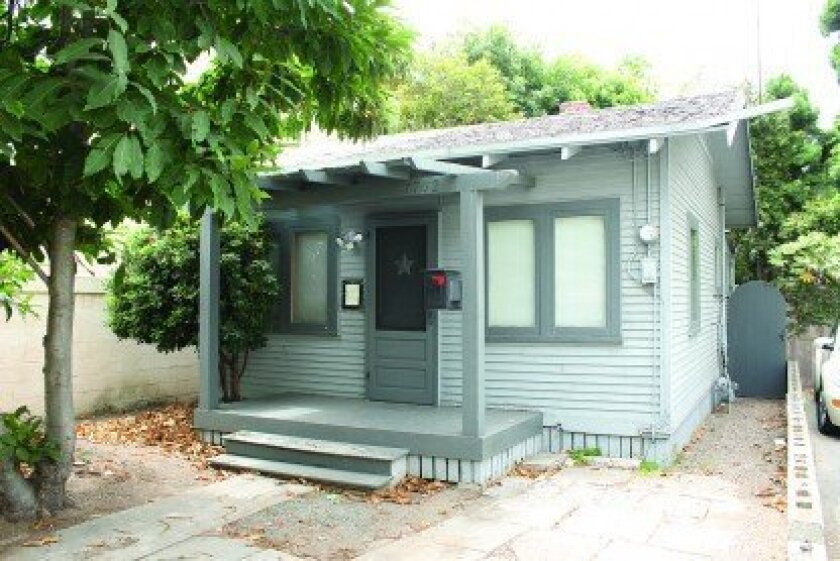 The La Jolla Historical society and Save our Heritage Organisation are working to uphold a local historic designation granted to this 1915 cottage at 7761 Eads Avenue.