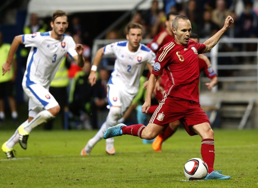 FILE - In this Saturday Sept. 5, 2015 file photo, Spain's Andres Iniesta kicks the ball before scoring from the penalty spot during a Group C Euro 2016 qualifying soccer match between Spain and Slovakia at the Nuevo Carlos Tartiere stadium in Oviedo, Spain. (AP Photo/Jose Vicente, FIle)