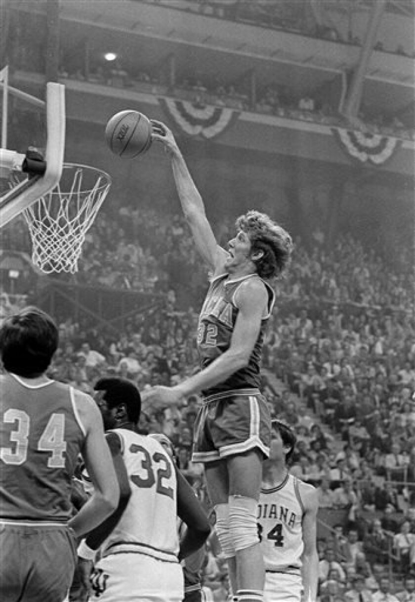 Helix High product Bill Walton, here scoring for UCLA in a 1973 Final Four Game, is representative of the huge number of tremendous athletes from San Diego County who had to go elsewhere to find national success and stardom. (AP Photo/File)