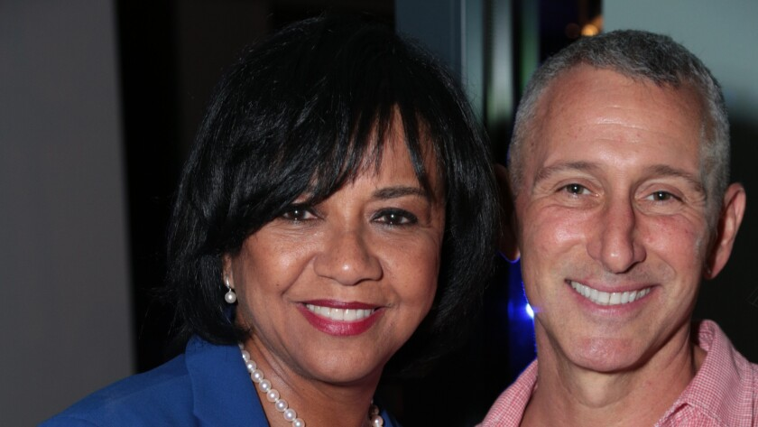 Cheryl Boone Issacs and Adam Shankman at Brian and Veronica Grazer's home.