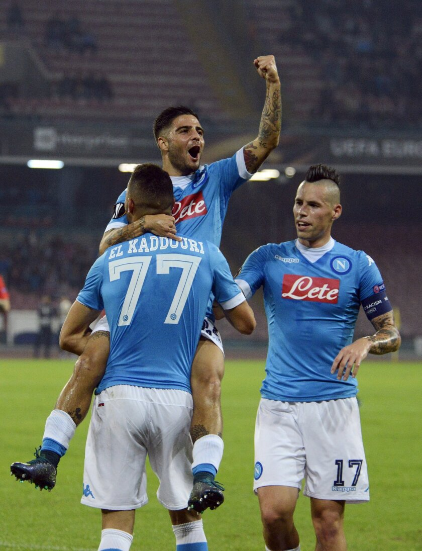 Napoli's Omar El Kaddouri, number 77, celebrates with teammates Lorenzo Insigne and Marek Hamsik, right, after scoring during the Europa League soccer match between Napoli and Midtjylland, at the San Paolo stadium in Naples, Italy, Thursday, Nov. 5, 2015. (AP Photo/Salvatore Laporta)