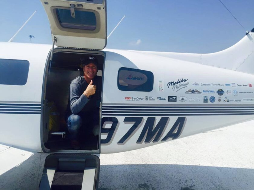 San Diego pilot Robert DeLaurentis completes his solo round-the-world flight over 22 countries Wednesday.