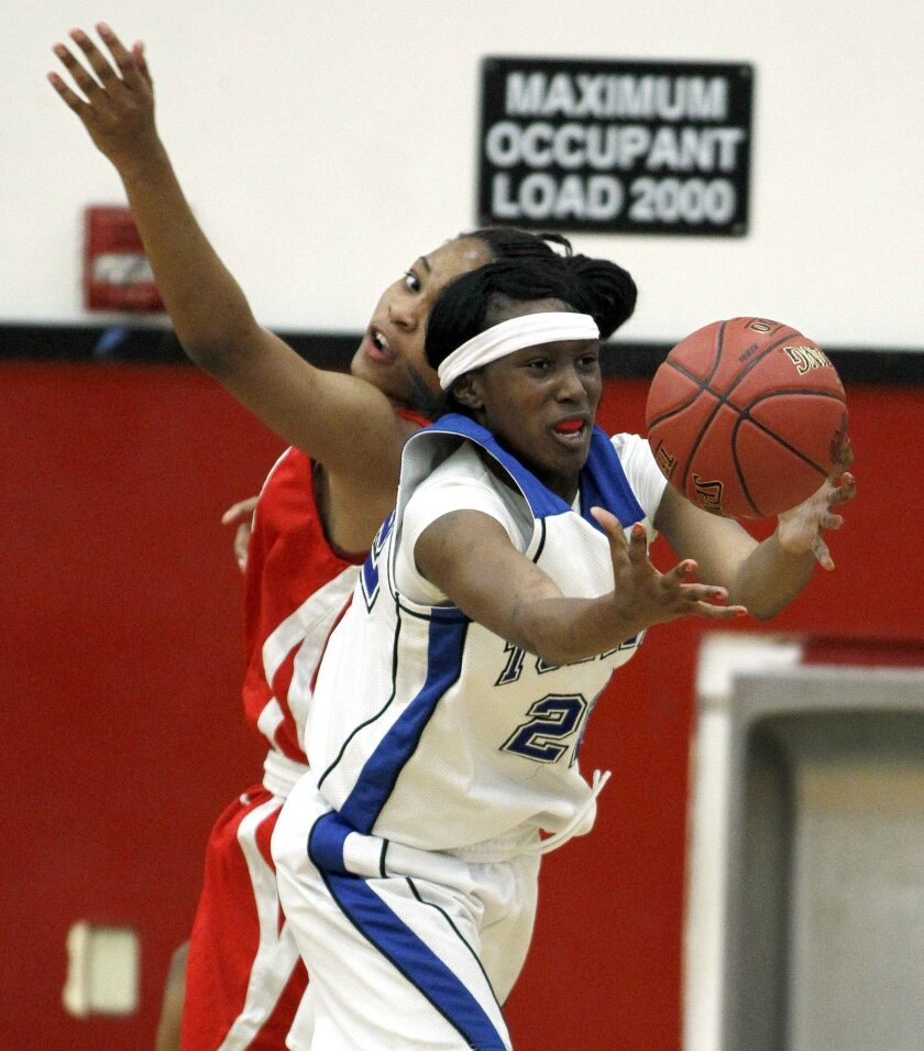 La Jolla Country Day's Maya Hood reaches for the ball against Serra. Torrey Times photo