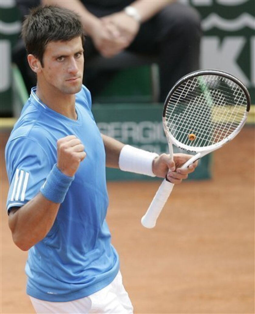 Serbia's Novak Djokovic reacts after winning a point during the semi-final match against Switzerland's Roger Federer at the Italian Rome Masters tennis tournament in Rome, Saturday, May 2, 2009. Djokovic won 4-6, 6-3, 6-3. (AP Photo/Gregorio Borgia)
