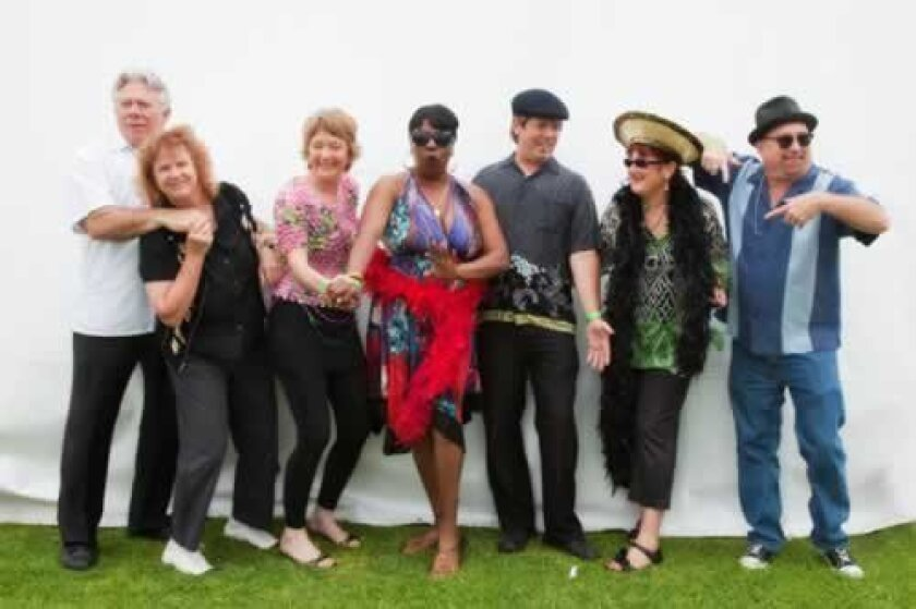 The 'Queen of Boogie Woogie,' pianist Sue Palmer (sixth from left) with her Motel Swing Orchestra — some of San Diego's greatest blues and swing musicians — Jonny Viau (sax), April West (trombone/vocals), Deejha Marie (vocals), Sharon Shufelt (drums/vocals), Pete Harrison (bass) and Steve Wilcox (guitar).