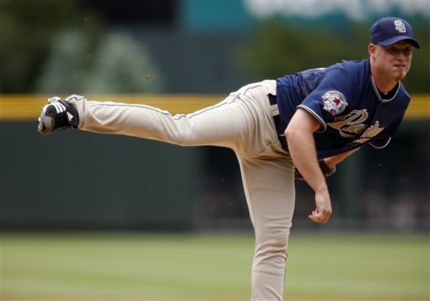 San Diego Padres pitcher Chad Gaudin works against the Colorado Rockies in the first inning of a baseball game in Denver on Sunday, May 31, 2009. (AP Photo/David Zalubowski)
