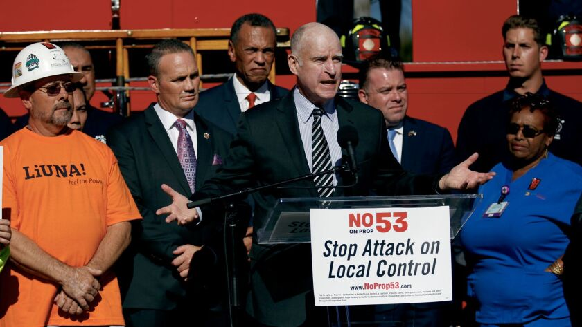 Gov. Jerry Brown speaks during a press conference opposing Prop 53 at the United Firefighters Headquarters in Los Angeles.