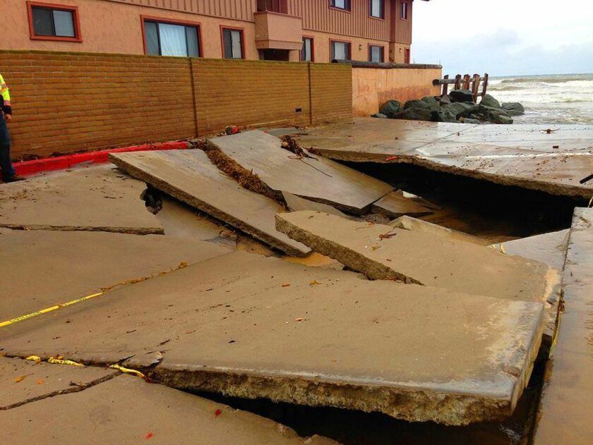 Several days of El Niño-related heavy rain and flooding has resulted in a sink hole on the west end of Avenida De La Playa in La Jolla Shores, as seen Thursday, Jan. 7.