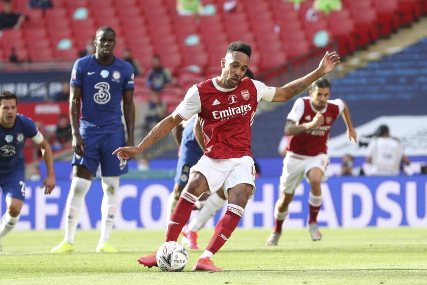 Arsenal's Pierre-Emerick Aubameyang scores his side's first goal from the penalty spot, during the FA Cup final in London.
