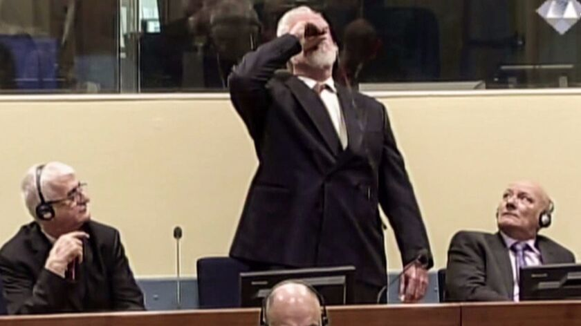 Former Croatian general Slobodan Praljak swallows what he said was poison after appeals judges at the U.N. war crimes court in the Hague upheld his 20-year jail term on Nov. 29.