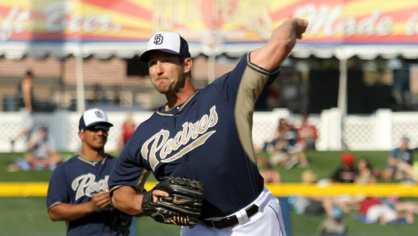 Padres pitcher Jason Lane throws warm-up pitches before entering a spring training game against the D-backs in Peoria, Ariz.
