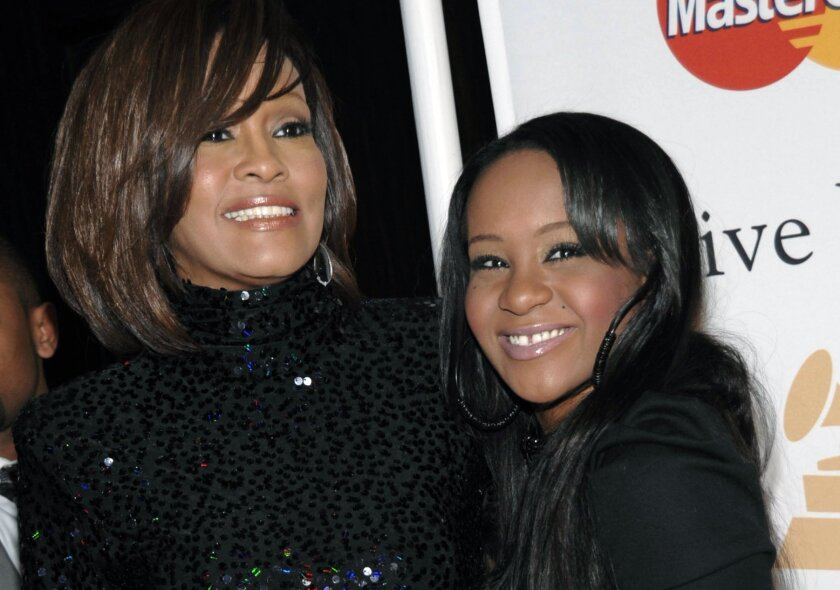 Whitney Houston, left, and daughter Bobbi Kristina Brown arrive at an event in Beverly Hills in February 2011.