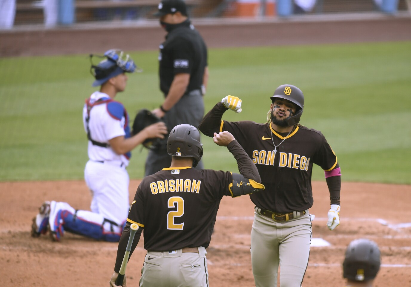 LOS ANGELES, CALIFORNIA - APRIL 25: Fernando Tatis Jr. #23 of the San Diego Padres celebrates his solo homerun with Trent Grisham #2, to trail 2-1 to the Los Angeles Dodgers, during the fourth inning at Dodger Stadium on April 25, 2021 in Los Angeles, California. (Photo by Harry How/Getty Images)