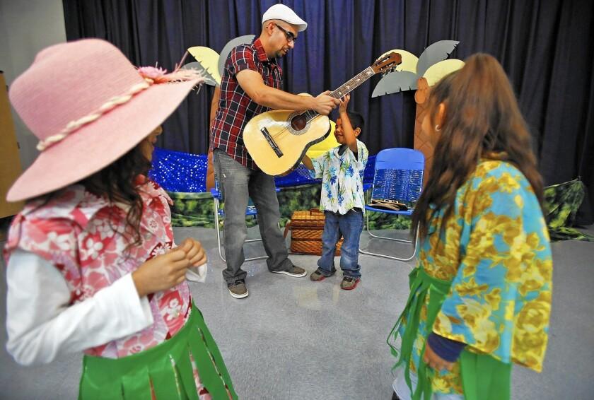 Arturo Avina and kindergarteners work on their video.