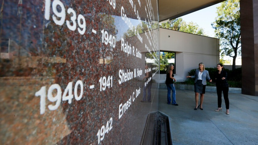The names of past Toastmasters presidents are etched in a granite wall outside the organization's headquarters in Rancho Santa Margarita.