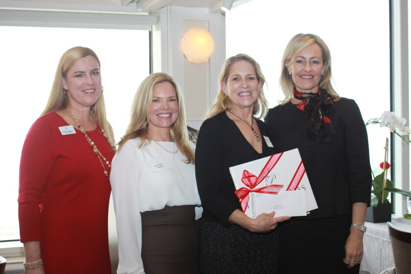 GenerateHope director of programs Susan Munsey (third from left) said the $32,000 grant will buy a transit wagon for transporting people to stores, appointments and more. She is joined by Jewel Ball co-chairs Kelley Albence and Maureen Weber, and chair Kathryn Gayner.