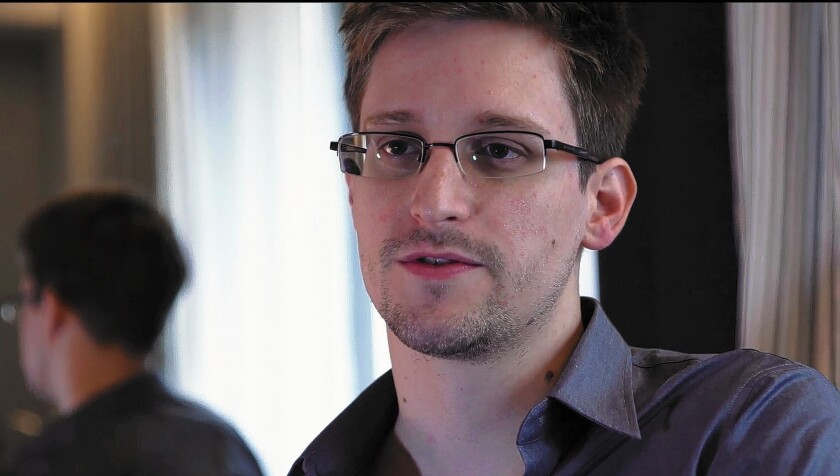 Former NSA contractor Edward Snowden has denied that he stole colleagues' passwords to gain access to classified documents.