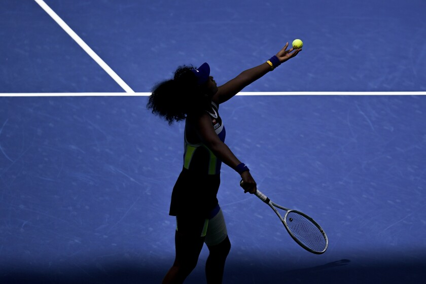 Naomi Osaka, of Japan, serves to Marta Kostyuk, of the Ukraine, during the third round of the US Open tennis championships, Friday, Sept. 4, 2020, in New York. (AP Photo/Seth Wenig)