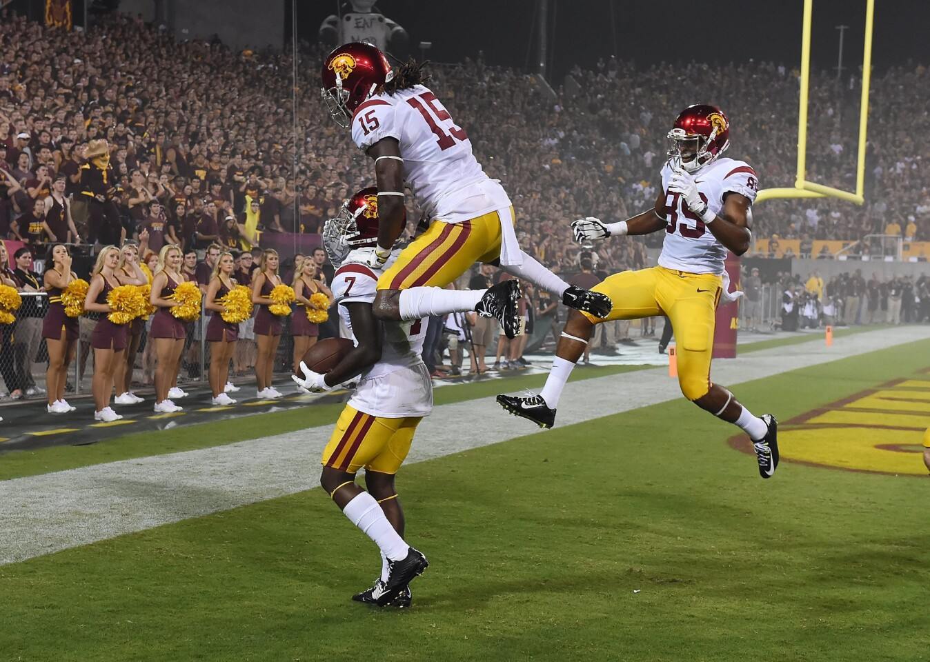 USC's Steven Mitchell Jr. (7) is joined in celebration by teammates Isaac Whitney (15) and De'Quan Hampton after his 27-yard touchdown reception in the second quarter Sept. 26 against Arizona State.