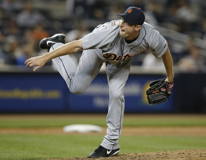 Detroit Tigers starting pitcher Max Scherzer follows through in the seventh inning of the Tigers 2-1 loss to the New York Yankees in a baseball game at Yankee Stadium in New York, Monday, Aug. 4, 2014. Scherzer allowed nine hits and two runs in seven innings. (AP Photo/Kathy Willens)