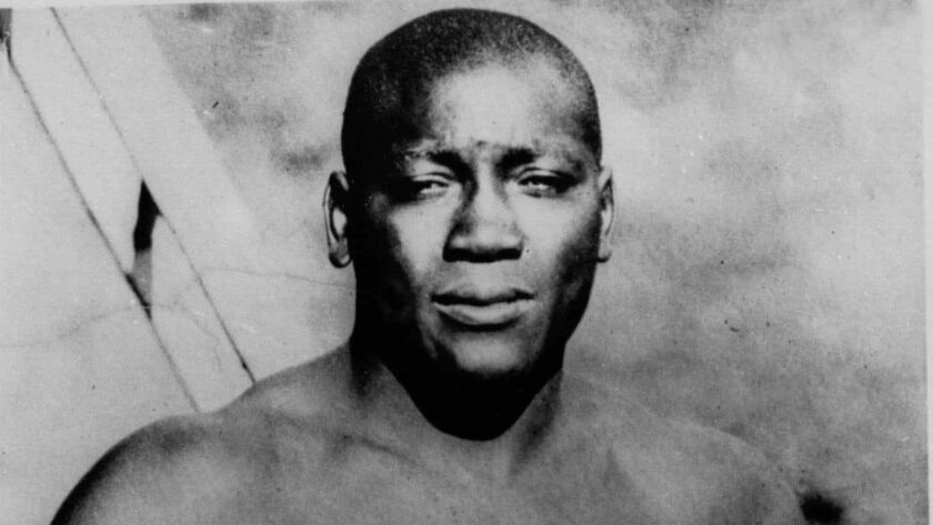 "FILE - This undated photo shows boxer Jack Johnson. President Donald Trump says he's considering ""a"