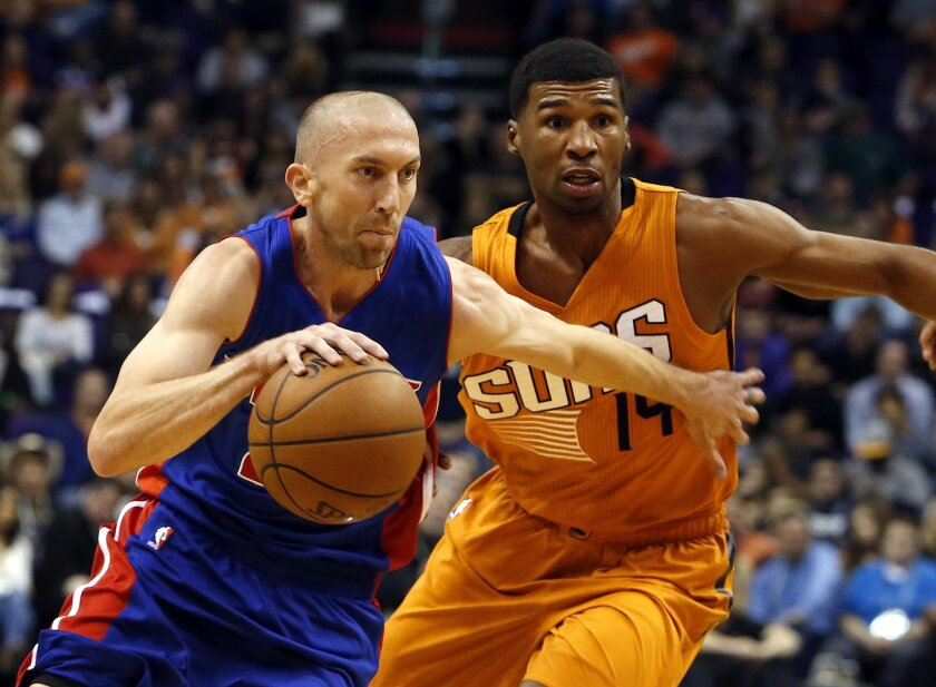 Detroit Pistons guard Steve Blake, left, drives past Phoenix Suns guard Ronnie Price (14) in the second quarter during an NBA basketball game, Friday, Nov. 6, 2015, in Phoenix. (AP Photo/Rick Scuteri)