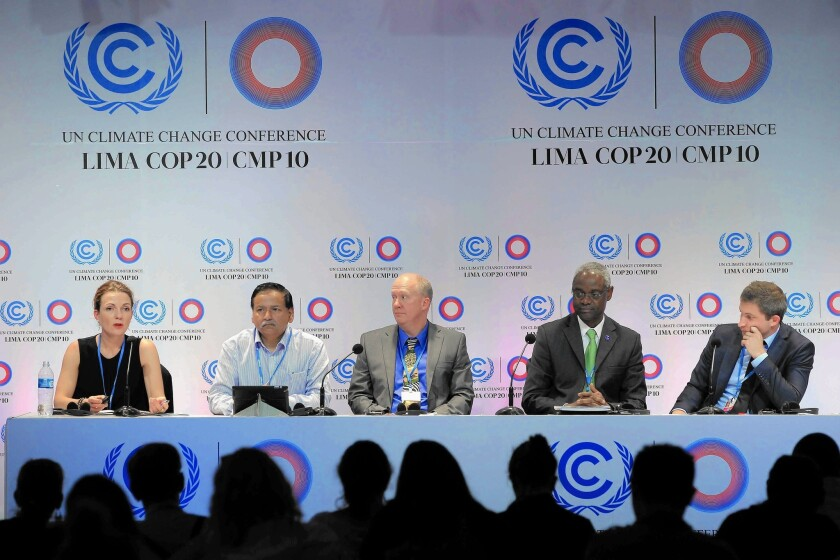 United Nations Environment Program Deputy Executive Director Ibrahim Thiaw, second from right, and colleagues present a study at the Climate Change Summit in Lima, Peru.